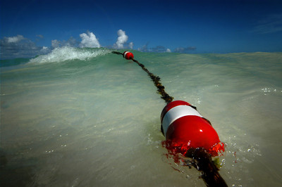 Buoy and cresting wave, Punta Cana, Dominican Republic