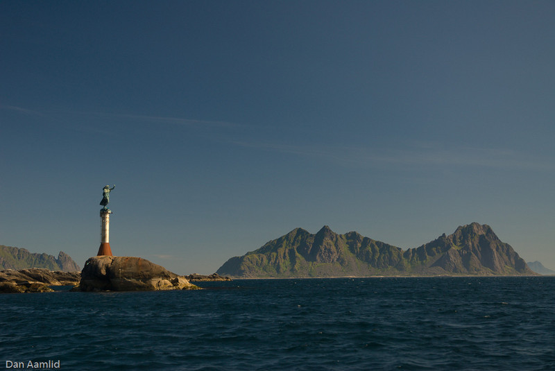 Stormolla island and the statue at the approach to Svolvær City, Lofoten