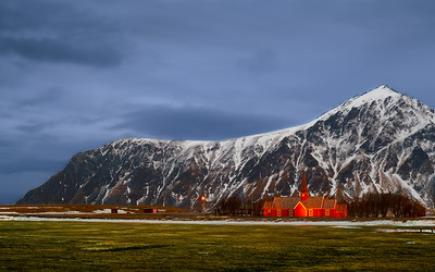 Flakstad Church in Lofoten landscape.