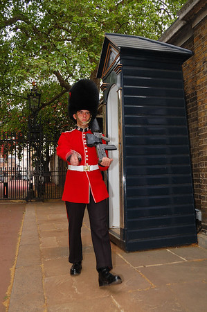 A Grenadier on guard at a St James Palace, Stable Yard Road off The Mall.