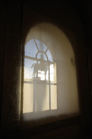 A shadow from the statue of Viscount Wolseley is projected onto a linen shade inside the Household cavalry Museum.