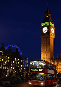 Three icons of London; Big Ben, The London Eye and a Double Decker bus, at dusk on a cold December afternoon.