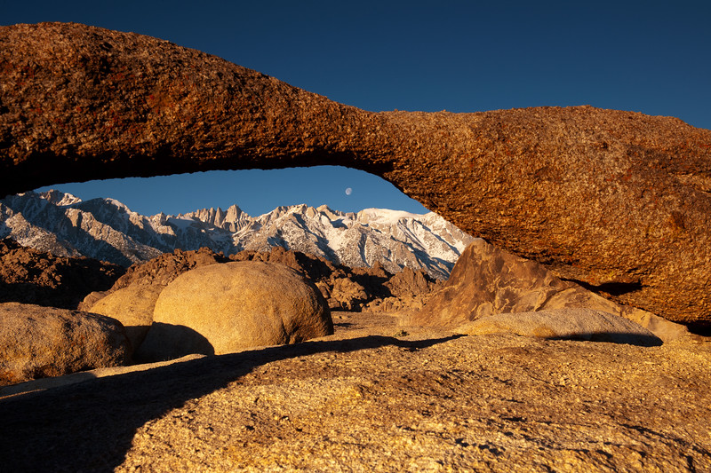 Sunrise on arch Alabama Hills and Mt. Whitney in the background