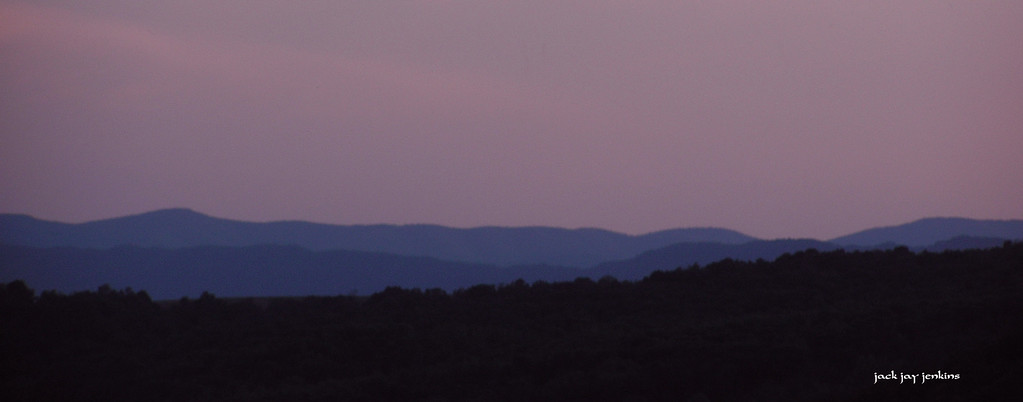 The pinks and reds and golds have disappeared; all that is left is a purple sky.