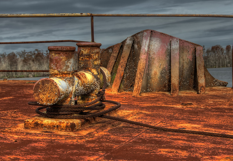 Old, rusted, ship tie down.