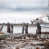"Shrimp boat ""Capt. W. J"" tied up to what remains of the dock in Cameron, Louisiana after Hurricane Rita tore through town."