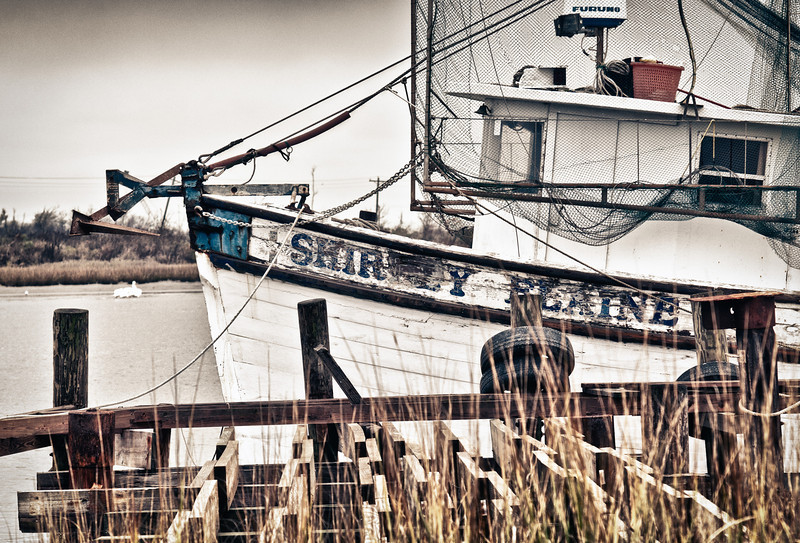 The Shirley Elaine shrimper tied up to the hurricane battered dock in Cameron, Louisiana