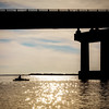 Kayak fisherman under the I210 bridge in Lake Charles, LA