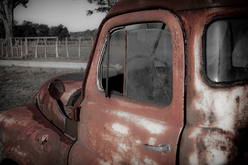 Looking out over hood at the final resting spot of this rusty old Dodge.