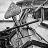 The rusty anchor of a shrimper.