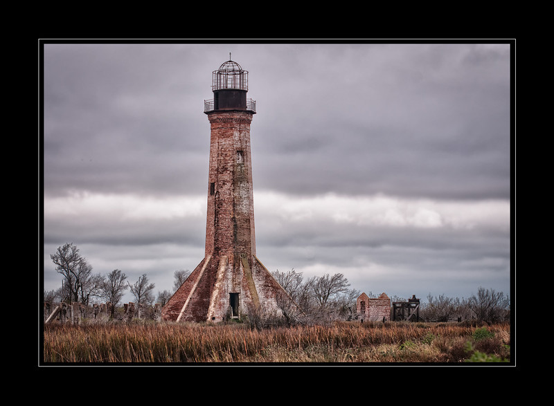 The Sabine Pass Lighthouse, 85 feet tall, built in 1855 at the mouth of the Sabine River.  Only the brick tower and oil house remain after years of harsh weather, neglect and vandalism.