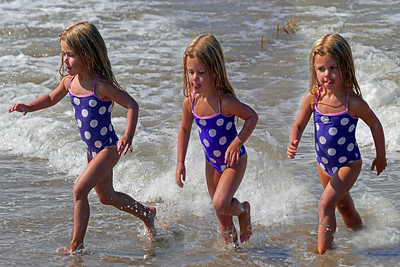 Playing in the Surf x3 ~ A composite showing this cute girl playing on the beach.  Love her expressions in each capture.