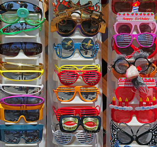 Fashion Statement ~ This photograph captures part of a display of sunglasses outside a shop on Venice Beach.  Viewing in the larger sizes shows reflections of beach activities in the sunglesses.