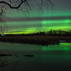 Northern lights shining over the Ottertail River