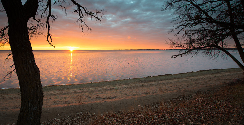 a bright sunrise over Otter Tail lake, MN