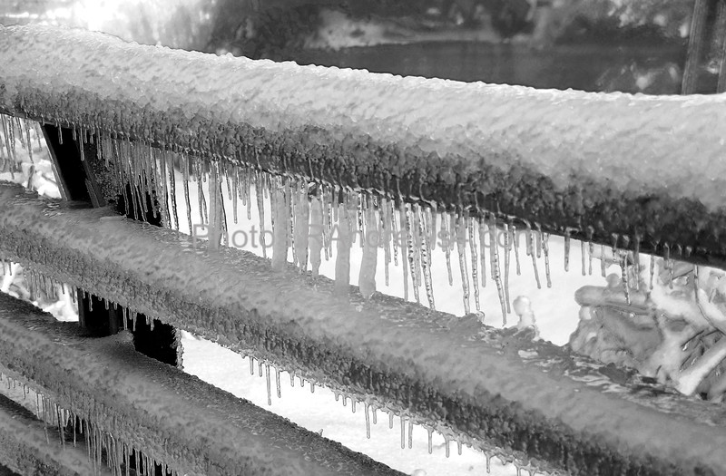 20110324 Railing in Lower Falls Park in Rochester, NY covered in ice, black & white