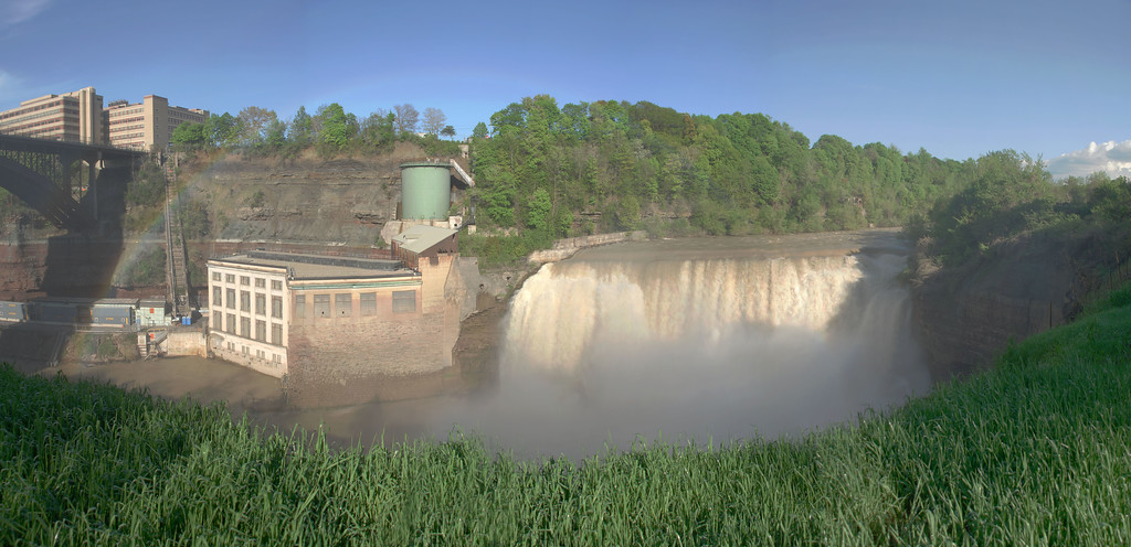 That is Kodak's Hawkeye plant above the gorge and an RG&E hydro power plant next to the Lower Falls of the Genesee River in Rochester, NY. That light colored band of sandstone just above the power plant is named Kodak Sandstone since this is the most prominent outcropping of this layer. With soft shale below it, Kodak Sandstone formes the crest of this waterfall.