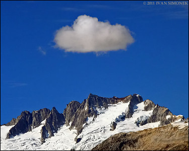 """STUBBORN CLOUD"",Coastal mountains along Stikine river,B.C.,Canada."