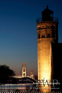 Old Mackinac Point Lighthouse with the Mackinac Bridge in the background.