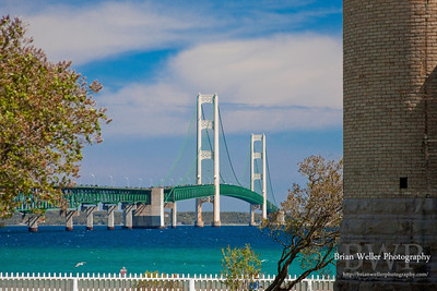 Daytime shot of the lighthouse framing the Mackinac Bridge.