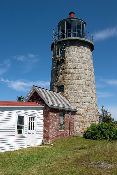 Light house at a small harbor in Maine