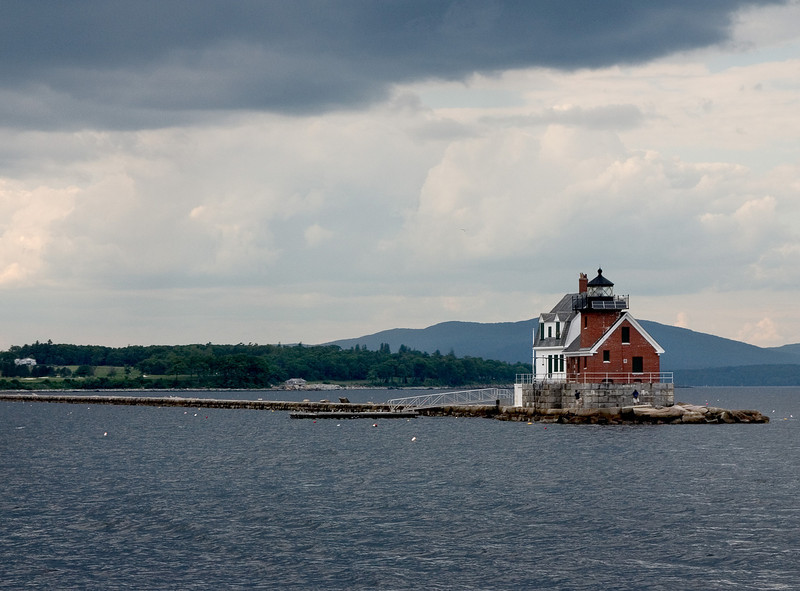 Light on a small brick lighthouse in Maine