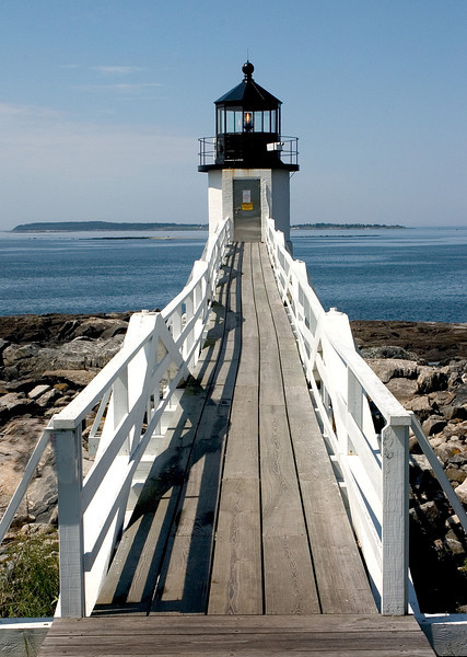 Light House in Maine with blue ocean in the distance