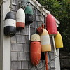 Pot Bouys hanging on a shed in Maine