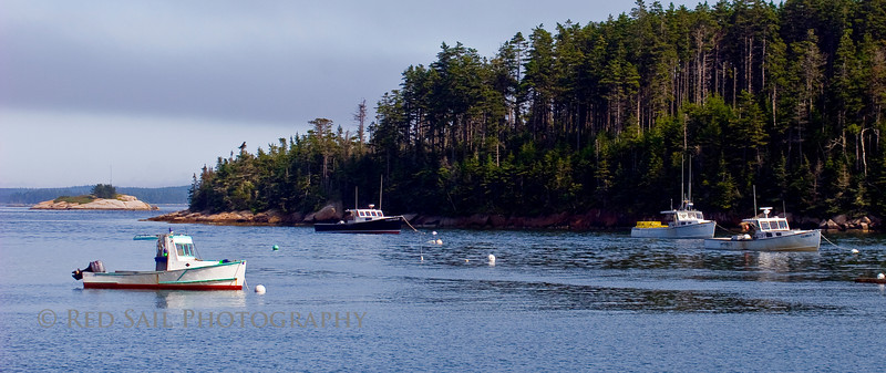 Lobster boats in Naskeag Harbor, Blue Hill Peninsula, Brooklin Maine. Harbor Island and Smuttynose Island in the background.