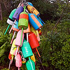 Lobster trap buoys decorate street sign. Lobster Lane.
