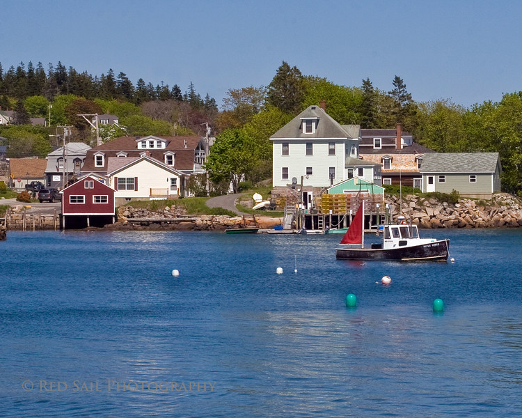 Stonington Harbor, Maine. Located on Deer Island, the southern most point of the Blue Hill Peninsula. Other lobster boats moor to the buoys seen in this image.