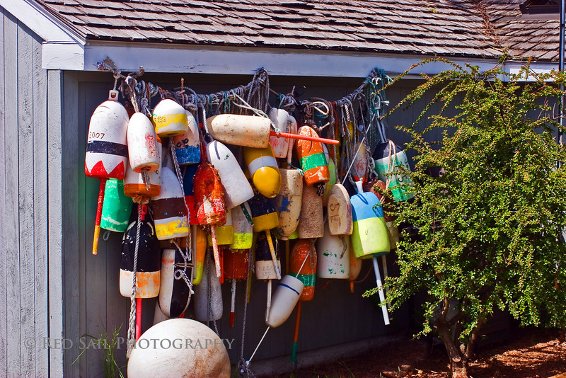 Lobster Trap Markers. For identification purposed, each marker or buoy is uniquely colored to represent the individual lobsterman. This image was taken at the Southwest Harbor Marina, Mount Desert Island, Maine.