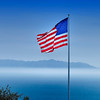 """American Flag"".  Patriotic flag flying over Palos Verdes coastline, Palos Verdes, CA."