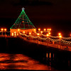 """""""Holiday Glow"""".  Holiday Pier Lighting, Manhattan Beach, CA.   Image published on the Front Cover of the """"South Bay Monthly"""" Magazine, December 2011 (Manhattan Beach, Hermosa Beach, Redondo Beach & El Segundo Issue)."""