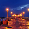"""Twilight Pier Glow'.  A glistening Manhattan Beach Pier during a thunderstorm.  Soon after this shot, the sky began to light up with LIGHTNING! (SEE LIGHTNING GALLERY) 1/21/10<br /> Image published on the front cover of the ""South Bay Monthly"" Magazine, February 2010 (Manhattan Beach, Hermosa, Beach, Redondo Beach & El Segundo issue)."