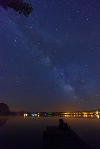 Woman on a dock admiring the night sky in Baldwin Mills