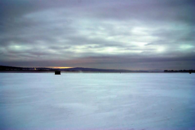 Daybreak <br /> <br /> Just before sunrise on Lake Carmi in Franklin Vermont. Fishing shanties dot the frozen mist filled horizon.
