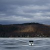 Ominous Ending<br /> <br /> Fishing shanty on the melting ice of Crystal  Lake in Vermont.