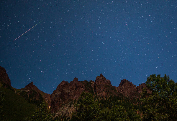 Meteor over the mountains of Colorado near the Maroon Bells
