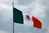 A massive Mexican Flag flies above the capital city.