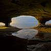 The view of Lake Superior from a water worn sand stone cave near Munising, Michigan.