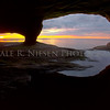 A sunset view of Lake Superior from a water worn sand stone cave near Munising, Michigan.