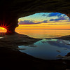 Lake Superior sunset from a water worn sand stone cave near Munising, Michigan.