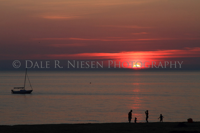 Sunset over Lake Michigan at Little Sable Lighthouse.