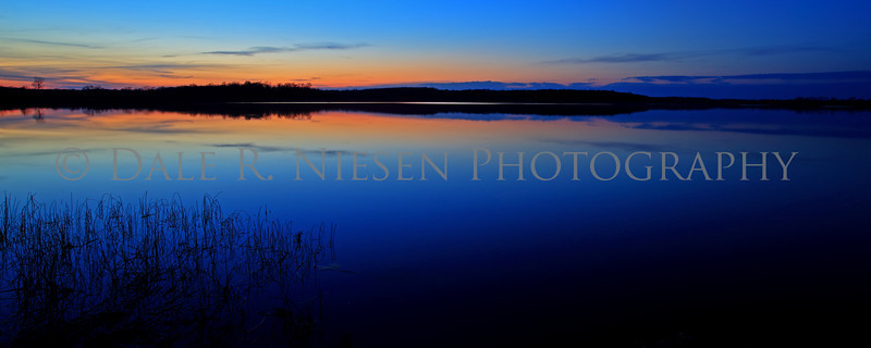 The blue hour after sunset at Fourmile Lake, Chelsea State Game Area, Washtenaw County, Michigan.