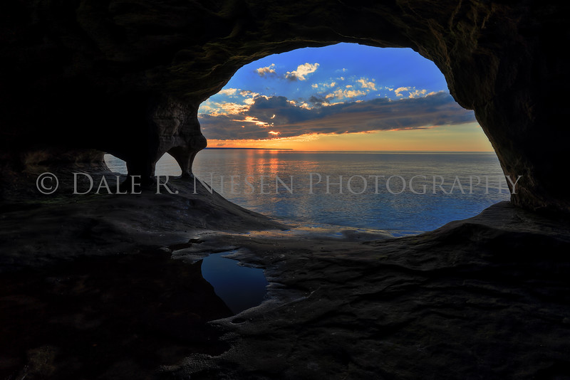 A Lake Superior sunset from a sand stone cave near Munising, Michigan