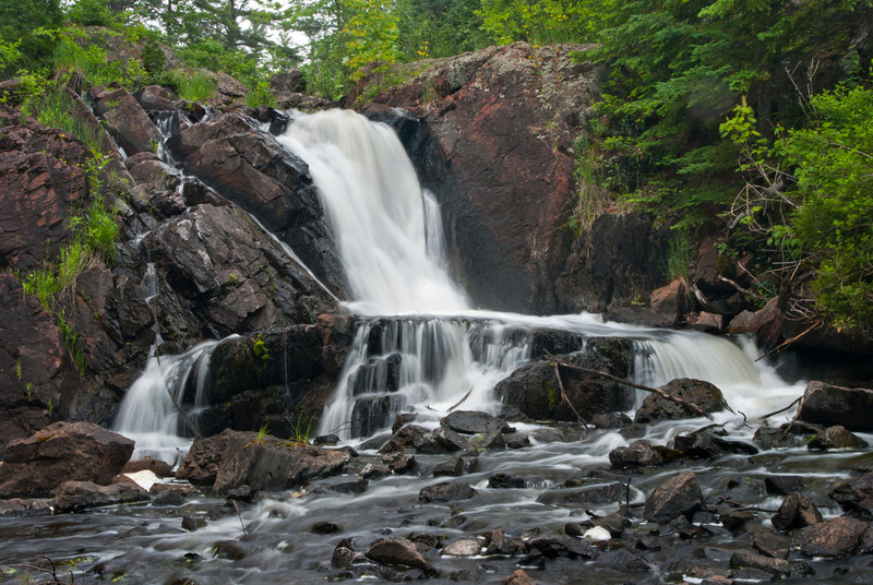 Not far from Palmer Michigan,Schweitzer Creek drops some 30-35 feet in two distinct stages to form Schweitzer Falls.