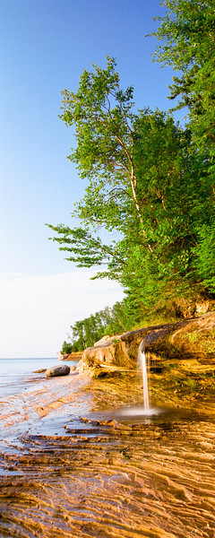 "Miners Beach  Miners Beach Falls is at the far east end of Miners Beach. Miners Beach is located at the end of Co Rd H-13 north-northeast of Munising MI on Lake Superior.  *For information on purchasing prints and canvas gallery wraps, click the ""Purchasing"" tab at the top of the page. If viewing on your mobile device, scroll to the bottom of the page and click the ""Full Site"" tab to view as if you were on your home PC and then go to the ""Purchase"" tab to for purchasing info. In mobile mode, you will not see the standard navigation bar with the ""Purchase"" tab."
