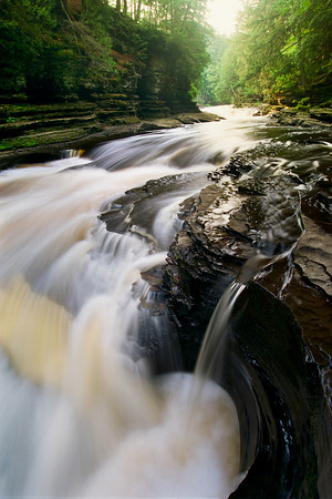 "The last stretch of falls as the Presque Isle River dumps into Lake Superior in Michigans Upper Peninsula at the Porcupine Mountains Wilderness State Park  *For information on purchasing prints and canvas gallery wraps, click the ""Purchasing"" tab at the top of the page. If viewing on your mobile device, scroll to the bottom of the page and click the ""Full Site"" tab to view as if you were on your home PC and then go to the ""Purchase"" tab to for purchasing info. In mobile mode, you will not see the standard navigation bar with the ""Purchase"" tab."