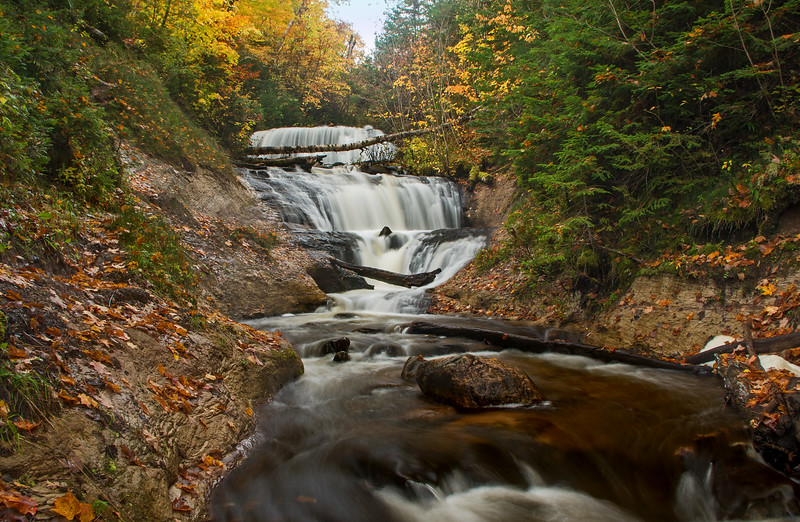 An autumn hike leads to Sable Falls in the Pictured Rocks National Lakeshore.